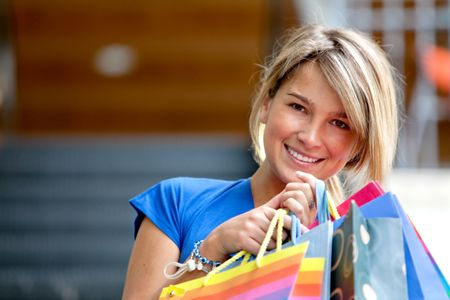 Beautiful girl with bags at the shopping center