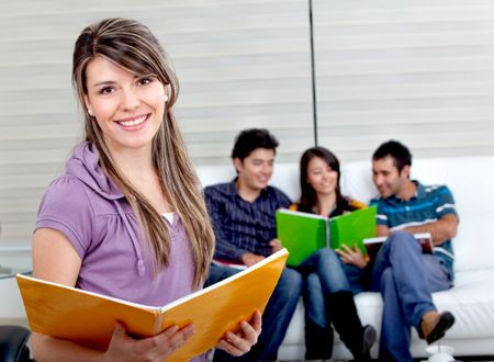 Beautiful female student with a group behind