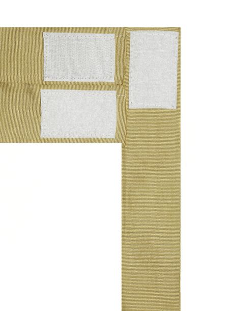 White velcro tabs on three tan strips of fabric isolated on white