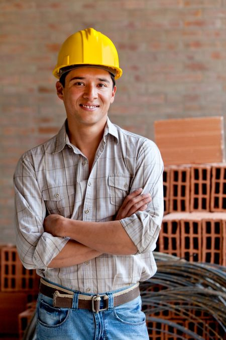 Male engineer smiling at a construction site