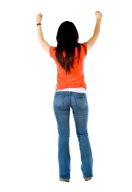 rear view of a successful girl looking happy with her arms up isolated