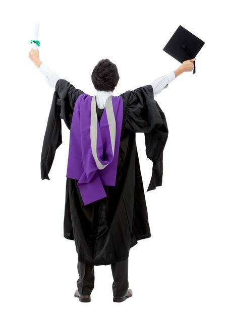 Rear view of a male graduate full of success with his arms up - isolated over white