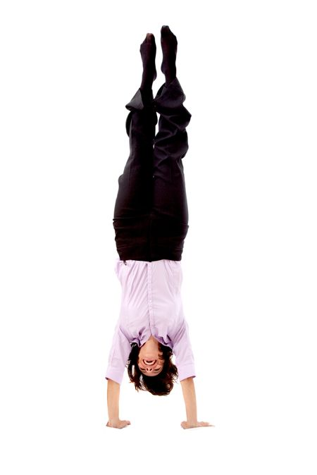 business woman doing the handstand isolated over a white background