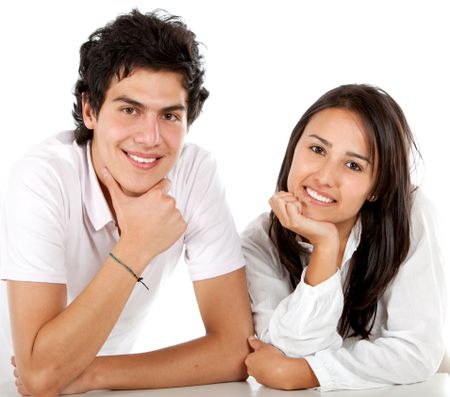 Beautiful couple portrait smiling isolated over white