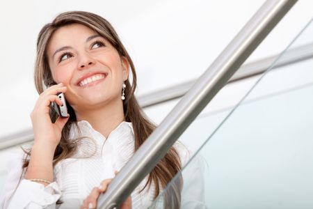 Business woman talking on the phone in her office