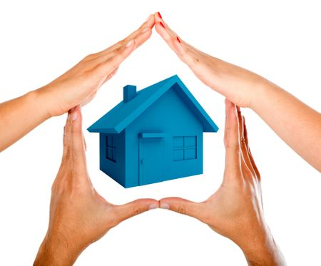 Hands making a house isolated over a white background