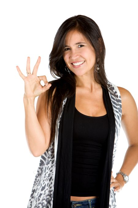 Woman making an ok sign isolated over a white background