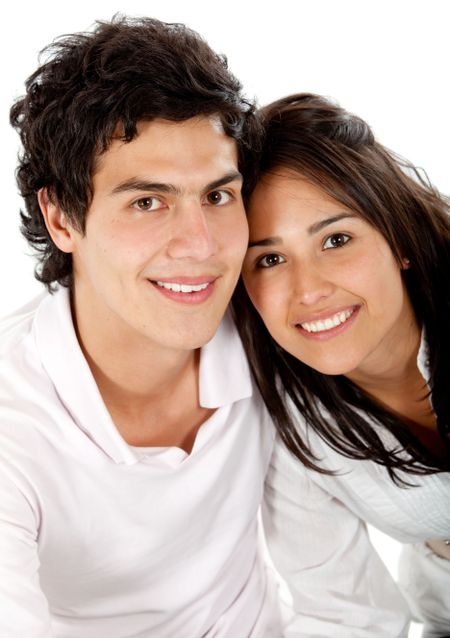 Beautiful couple portrait looking happy isolated on white
