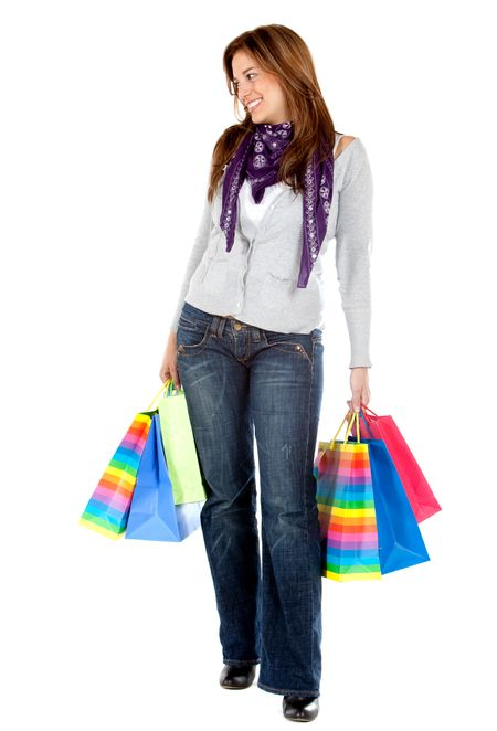 Fullbody woman with shopping bags isolated over a white background