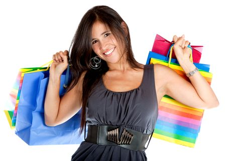 Woman with shopping bags smiling isolated over a white background