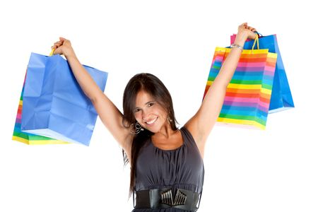Happy shopping girl with bags isolated over a white background