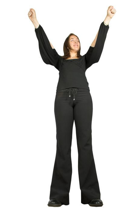 business woman celebrating with arms up