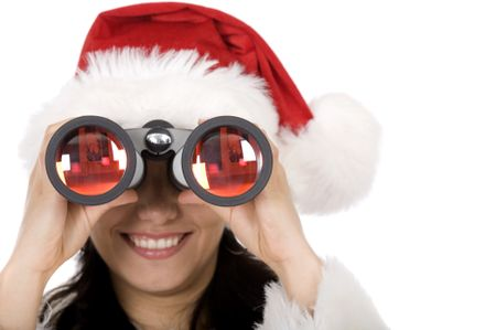 beautiful female santa holding binoculars over a white background