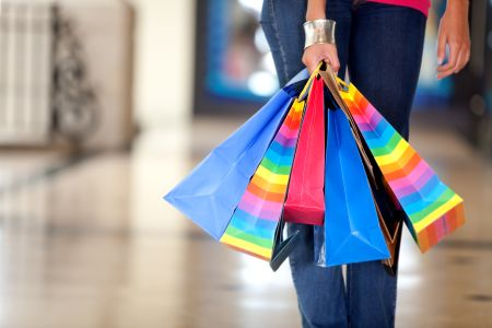 Unrecognizable woman holding bags in a shopping center