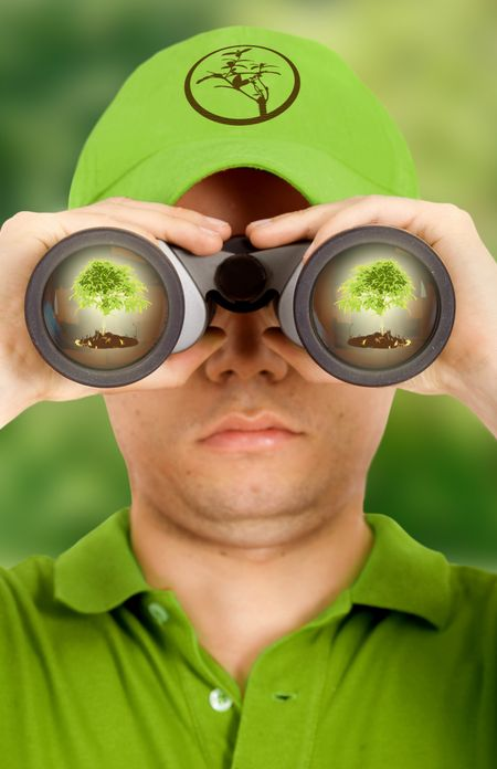 ecologist searching for environmental protection dressed in green
