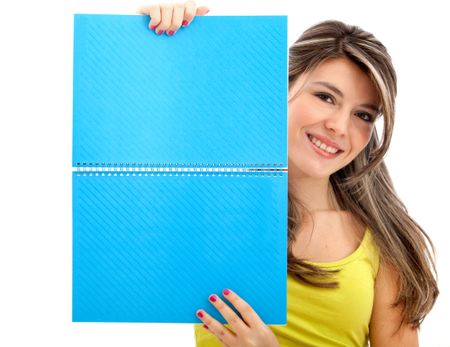 Girl holding a notebook isolated over a hwite background