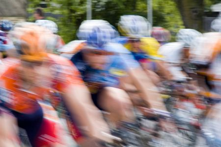 Bicycle racers speed toward camera