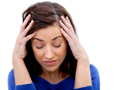 Concerned woman holding her head isolated over a white background