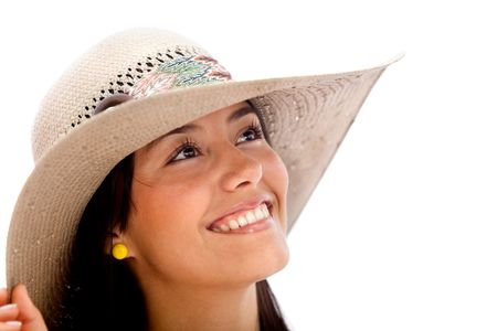Beautiful summer woman smiling wearing a hat over a white background