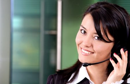 business customer support girl with a headset in an office