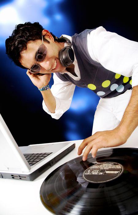 disc jockey in a nighctlub having fun with the music
