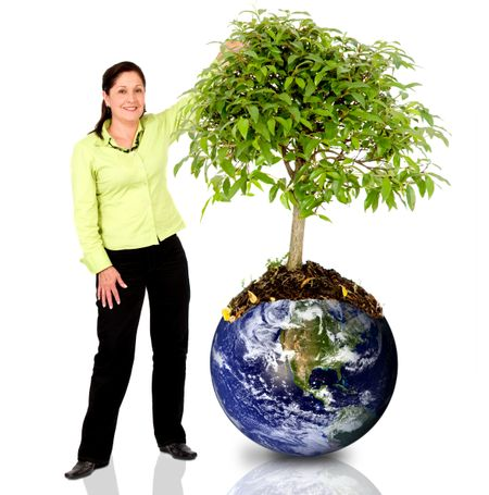 woman next to a tree growing from the earth over a white background