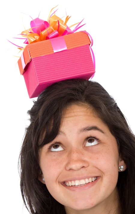 girl with gift on top of her head over a white background