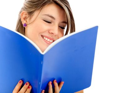 Female student reading a book isolated over a white background
