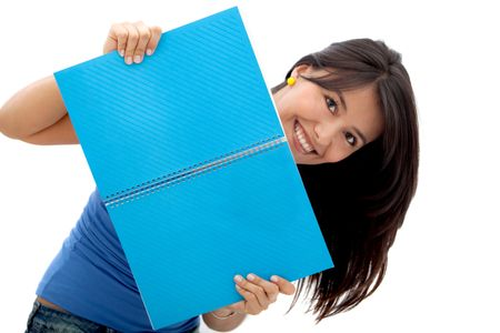 Fun female student smiling with a notebook - isolated over a white background