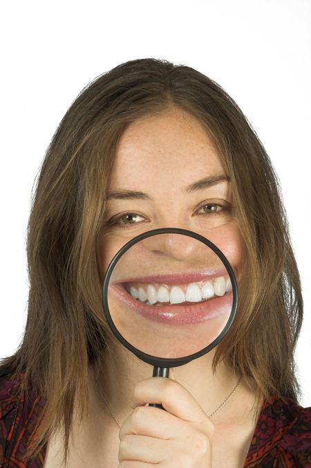 humorous photo of a casual woman with a big smile