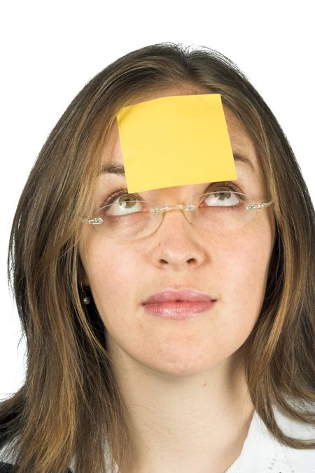 business woman with a post-it note on her forehead