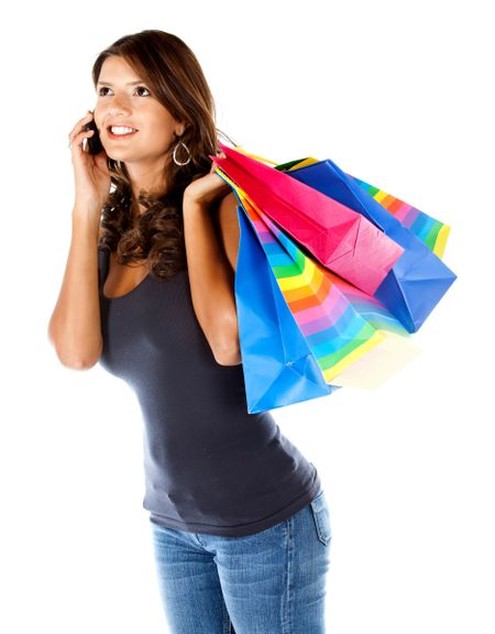 Shopping woman talking on the phone isolated over a white background