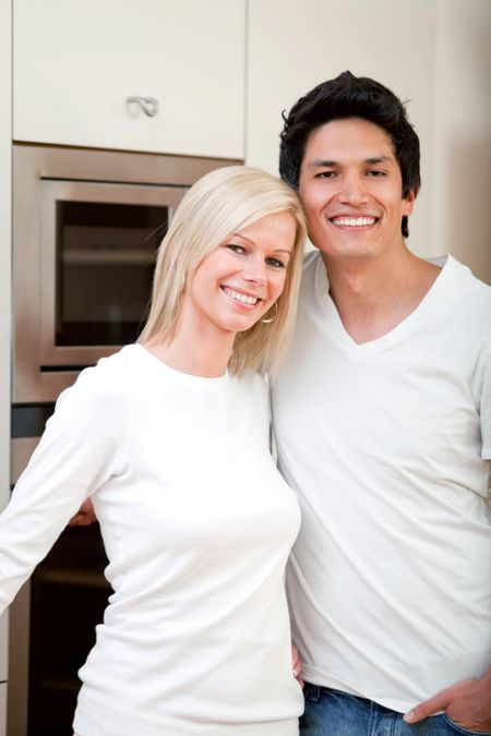 Beautiful couple portrait smiling at home