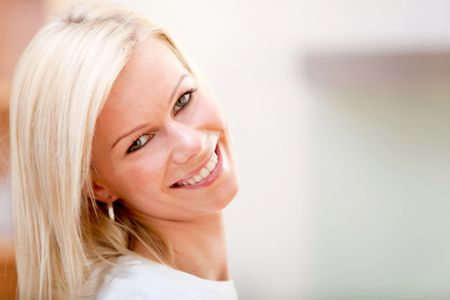 Portrait of a beautiful blonde woman smiling indoors