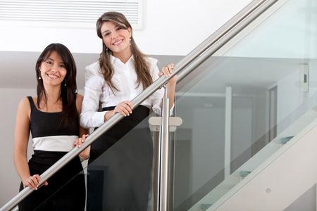 Beautiful young business women smiling at the office