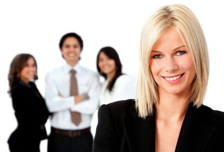 Beautiful business woman smiling with a group behind her isolated over a white background