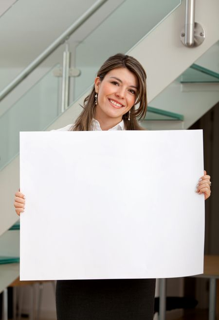 Business woman at the office holding a banner
