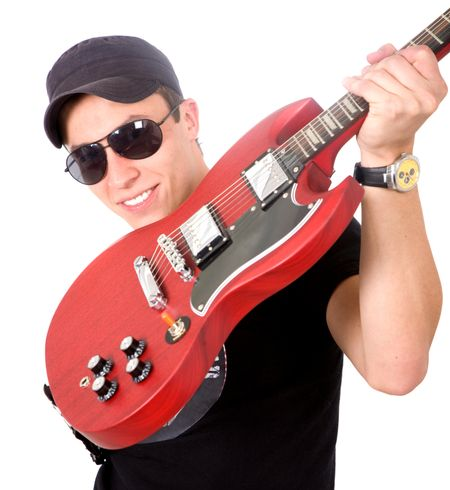 male electric guitar player smiling and wearing sunglasses over a white background