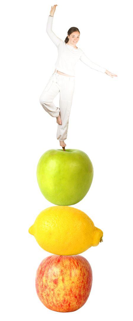 Casual girl balancing on fruits