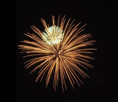 """Small white burst of fireworks """"inside"""" much larger reddish-orange burst"""