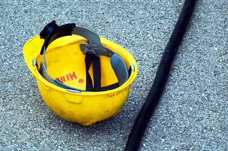 Yellow hardhat by cable on ground