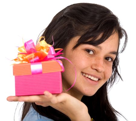 casual girl holding a gift smiling over a white background