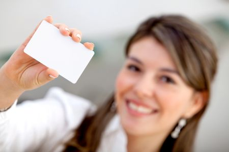 Woman displaying a personal business card at the office