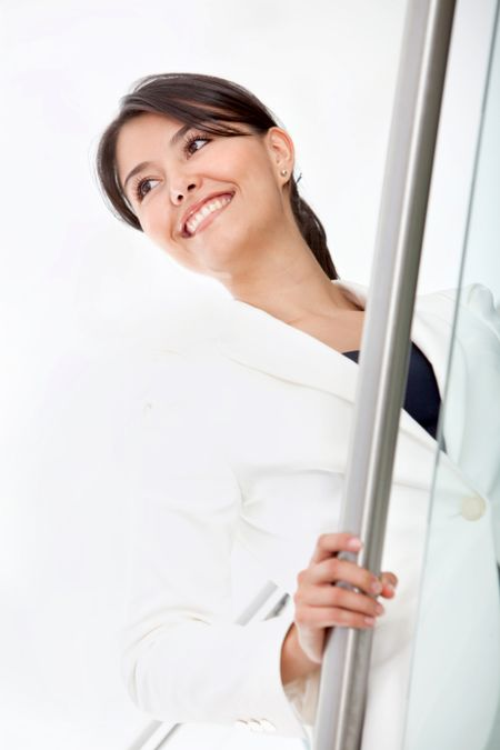 Confident business woman at the office smiling