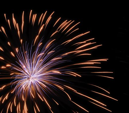 Bluish burst of fireworks inside reddish-yellow streaks from previous burst, off center