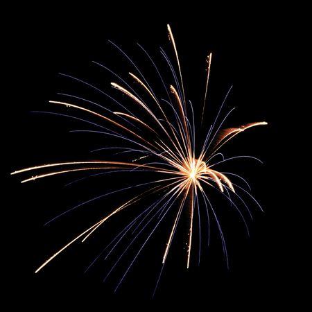 Blue and reddish burst of fireworks, off center, on square black background
