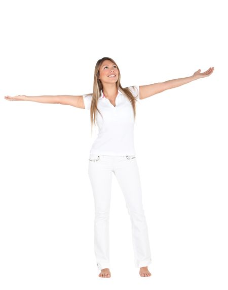 Excited fullbody woman in white with arms opened - isolated