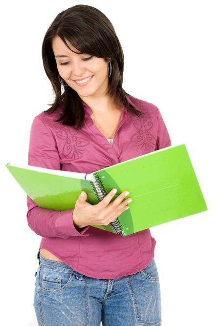 female student reading a notebook over a white background