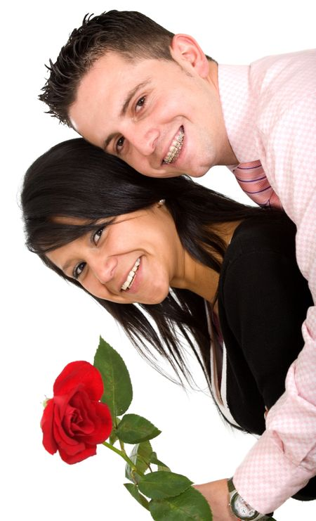 happy couple with rose over a white background where the guy has braces