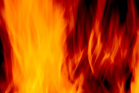 abstract blur of a fire over a black background